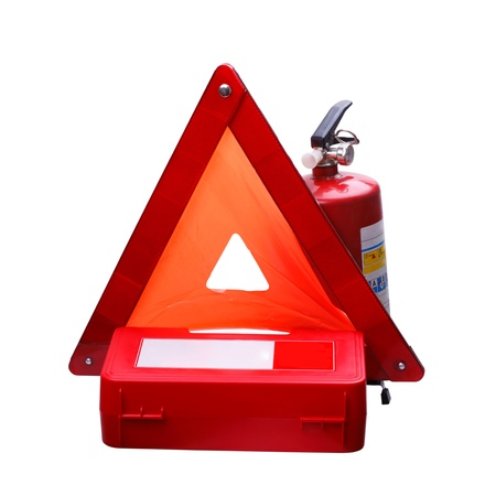 First Aid Kit, Warning Triangle and Fire Extinguisher on a white background photo