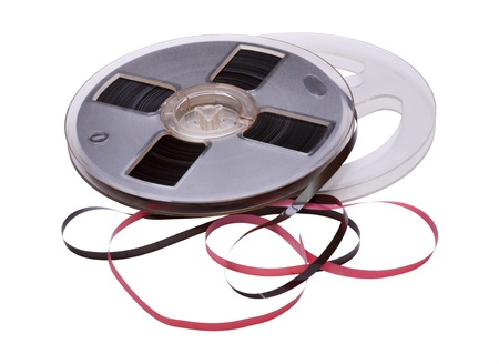 A vintage Reel-To-Reel of audio tape on a white background  Stock Photo