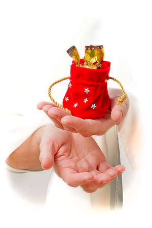 Human hands with Christmas gifts on a white background photo