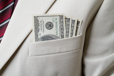 breast pocket: Businessman with dollars in the breast pocket