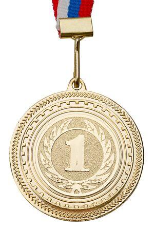 Medalla de oro de cerca. Aislado sobre fondo blanco Foto de archivo
