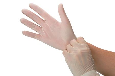 Hand In Op Handschuhe Mit Fünf Münzen Isoliert Auf Einem Schwarzen
