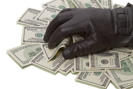Heap dollars and hand in a black glove isolated on white background photo
