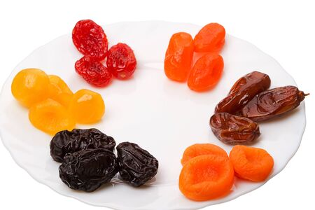 Six kinds of Dried fruit - prunes, apricots, figs, dogwood and date. Stock Photo - 12376650