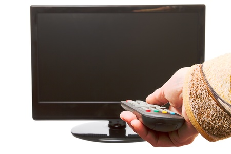 The hand with the remote control and TV isolated on a white background photo