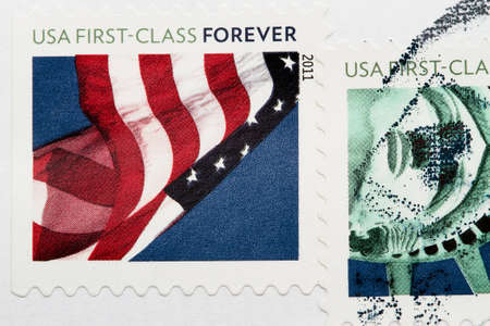 Stamp with United States of America flags. Postmarks stamps on a white envelope photo