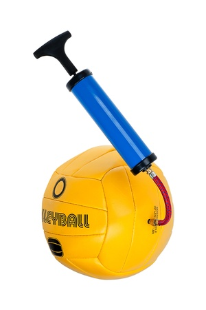Pump and yellow volleyball isolated on white background Stock Photo - 13340221