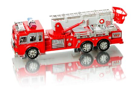Miniature fire truck isolated on a white background Stock Photo - 13046135
