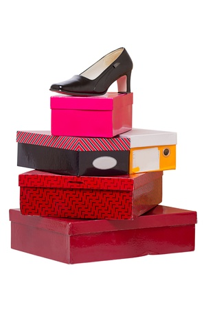 Womens shoes and boxes isolated on white background photo