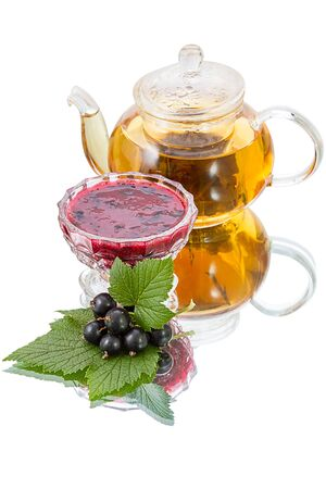 Preserves of black  currant, ripe berry and teapot with green tea photo