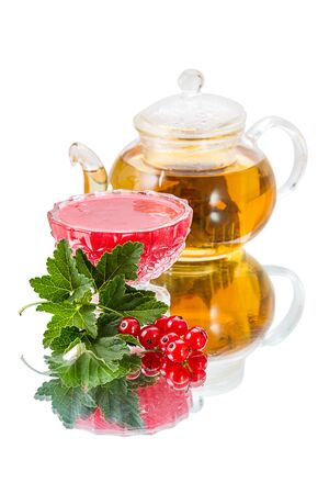 Preserves of red currant, ripe berry and teapot with green tea photo