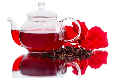 Hibiscus - flower, dry tea and brewed tea in a teapot. Isolated on a white background