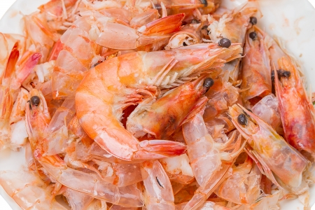 wastes: Pile of cooked and peeled shrimp. Detail of the heads and eyes of this seafood. Wastes from cleaning cooked Shrimps.