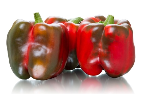 красноватый: Three reddish sweet peppers  Isolated on white background
