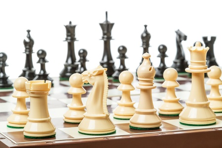 bishop chess piece: Chess board set up to begin a game  Isolated on white background Stock Photo