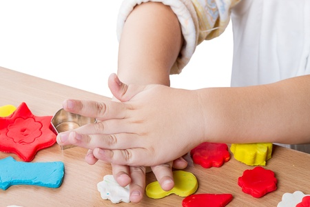 modelling clay: Hands of a Child make figurines of modelling clay Stock Photo