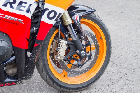 Tambov, Russian Federation - September 8, 2012   Photo of the Honda CBR motorcycle front wheel with Michelin tires and disc brakes Tokico  Shot outside in the natural light