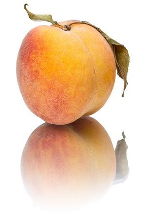 Peach with reflection isolated on a white background photo