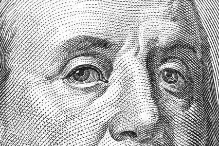 ben franklin: Macro shot of the eyes of Ben Franklin from a $100 bill.