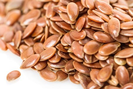 flax seed: A pile of flax seed close-up. Food background pictures.  Stock Photo