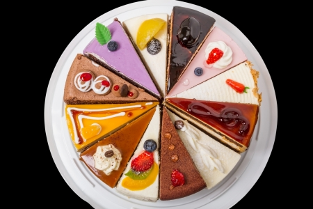 Twelve different pieces of cake. Isolated on black background. Top view close-up Stock Photo - 20379307