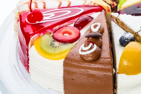 Original pieces of cake with fresh fruit and chocolate Stock Photo - 20584734