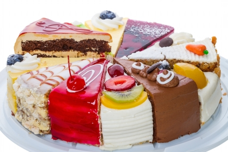 Various pieces of original cake on white Stock Photo - 20584684