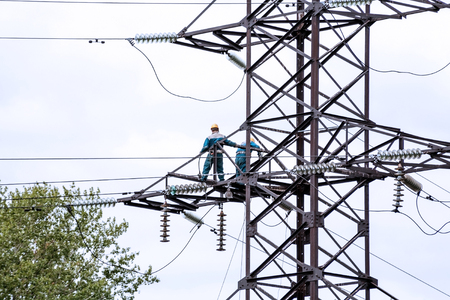 unrecognizable people: Repair work on a high-power lines. Electricity Industry. Unrecognizable people
