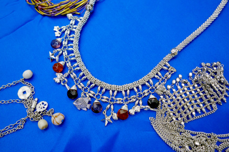 Indian silver necklace with ornament on blue Stock Photo - 22438459