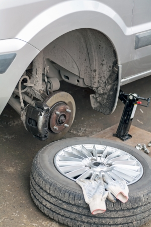 Front Disc Brakes with caliper on car and remove the wheel  photo