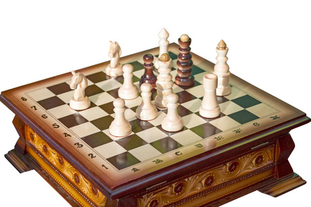 battling: Chess board with figures  Isolated on white background Stock Photo