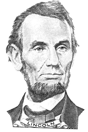 Portrait of Abraham Lincoln in front of the five dollar bill