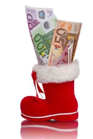 Red Christmas boot with Euro banknotes  isolated on white background photo