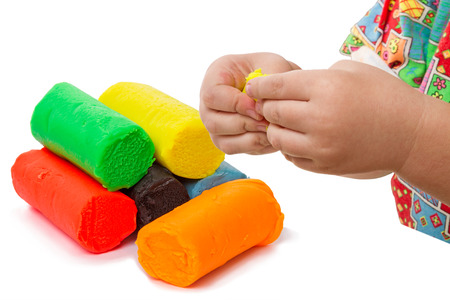 clay modeling: Child and set of six colors of Modeling clay Stock Photo