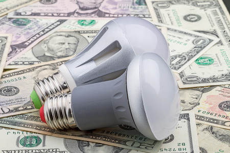 e27: Two LED electric bulb with an E27 base on dollar  90  saving money Stock Photo