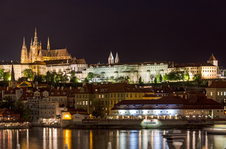 proclaimed: Prague, Czech Republic - May 10, 2014:  Night on the left bank of the Vltava River. Hradčany was an independent borough until 1784, when the four independent boroughs that had formerly constituted Prague were proclaimed a single city.