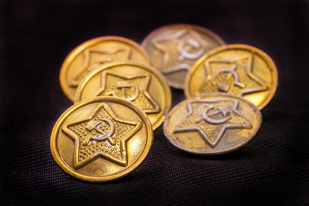 Old military buttons with Soviet symbols