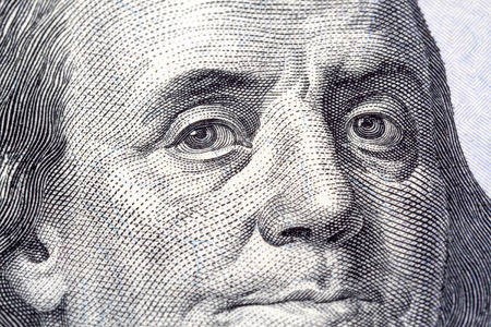 benjamin franklin: Portrait of Benjamin Franklin in front of the one new hundred dollar bill