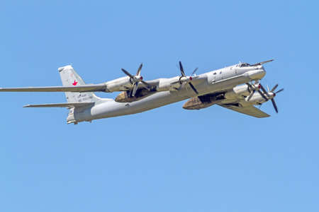turboprop: Tambov, Russia - May 31, 2014   Tu-95MS  product  B , NATO reporting name  Bear   - a Soviet   Russian turboprop strategic bomber, the fastest propeller aircraft  Sunny summer day