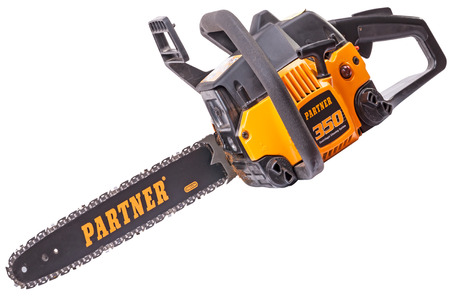 Tambov, Russia, May 27, 2010:  Partner 350 - chainsaw is ideal for use in the private sector. Partner in 1949 produced the first Swedish chainsaw. Partner today is part of the Husqvarna Group and continues to produce effective products for gardening.