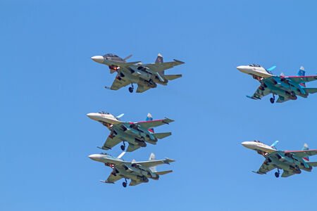 maneuverability: Tambov, Russia, May 31, 2014:  Traditional air show in Tambov. Four jet fighter aircrafts Su-27 (Flanker) and   Su-30SM  (Flanker-C) in the blue sky.  Sunny summer day