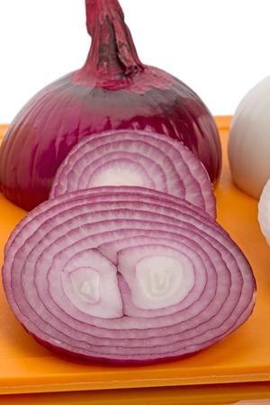 spanish onion: Slices Spanish Onion on the cutting board