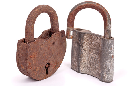 Two old rusty padlocks isolated on white background photo