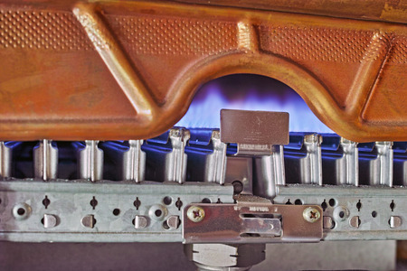 Blue flames of a gas boiler to heat your home photo