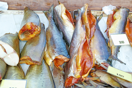 three shelves: Smoked fish three varieties on store shelves Stock Photo
