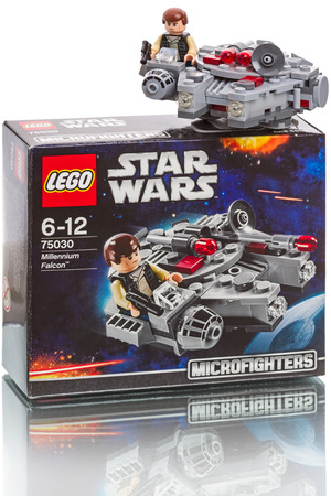 Tambov, Russia - October 04, 2014:  LEGO Star Wars - Millennium Falcon. Lego is a line of construction toys manufactured by the Lego Group, a privately held company based in Billund, Denmark. LEGO box. Items: 75030