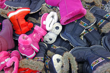 no heels: Pile of warm boots for children and adults