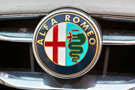 alfa: Tambov, Russia -  - November 13, 2014:  The sign of Alfa Romeo on the hood of car. Alfa Romeo Automobiles S.p.A. is an Italian manufacturer of cars. Founded as A.L.F.A. on June 24, 1910 in Milan.