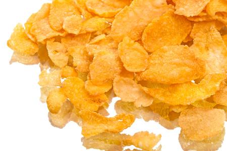 crimp: Crispy corn flakes with reflection isolated on white background