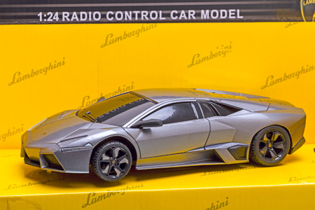 lamborghini: Tambov, Russia - February 6, 2015:  Radio-controlled toy Lamborghini Reventon in a box. 1:24 scale model. Automobili Lamborghini is an Italian brand and manufacturer of luxury sports cars.